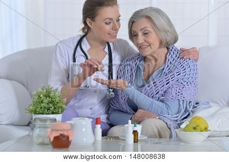young doctor and her senior senior patient on consultation
