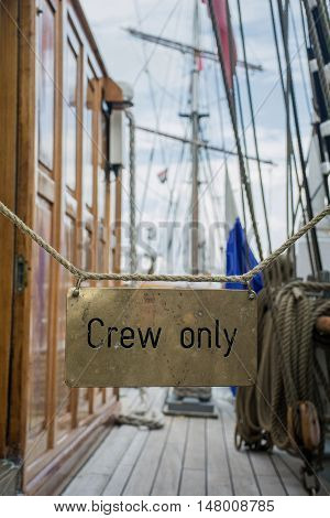 Deck on the ship with sign Crew only