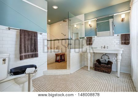 Blue Bathroom Interior With White Tile Trim Wall, White Sink And Bath Tub