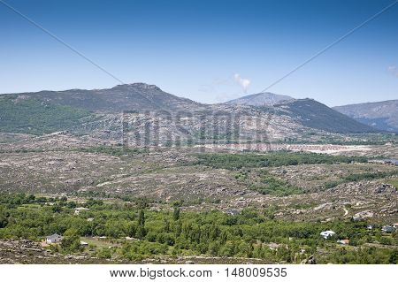 Urbanization at the foot of the mountain in Guadarrama Mountains, Madrid, Spain