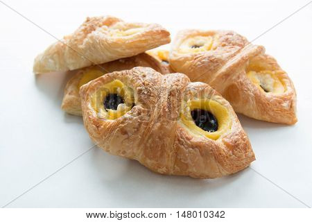 Danish pastry with blueberry on white background.