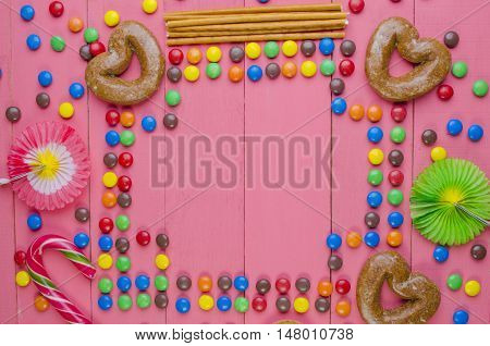 Frame From Candies On A Pink Background