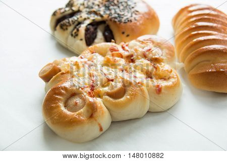 Assorted kinds of breads on a white background