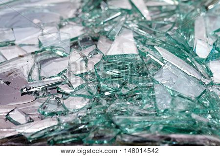 Close up photo of a broken car window