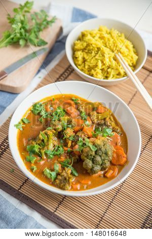 home made indian curry with rice in a bowl