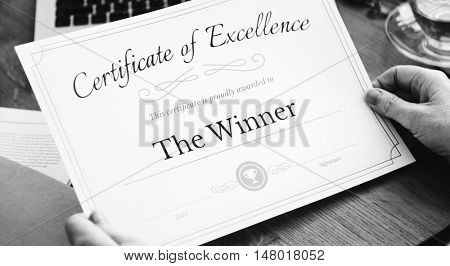 Senior Adults Reading Holding Certificate Concept