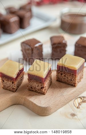 Chocolate dominos with christmas decoration on a plate