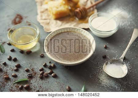 Natural scrub of sugar, honey and coffee on grey background