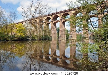 Old viaduct in Bietigheim reflected in the river. Baden-Wurttemberg, Germany.