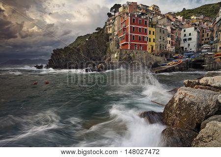 Riomaggiore. Image of Riomaggiore (Cinque Terre, Italy), during dramatic sunset.