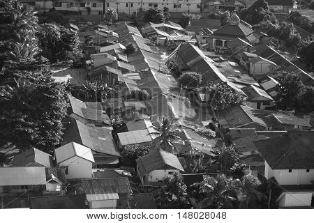 Abstract image of asian slums dense village house roof in black and white monochrome photo