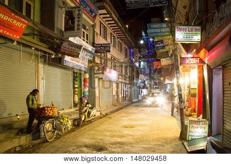 Kathmandu, Nepal - October 18, 2014: Closed shops in an almost empty shopping street in Thamel district by night