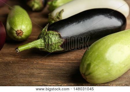 Fresh eggplants on wooden background