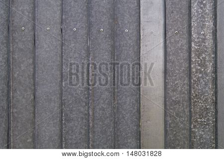 Aluminum fence with screws texture backround. iron