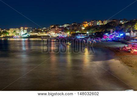 Night photo of beach and new part of Sozopol, Burgas Region, Bulgaria