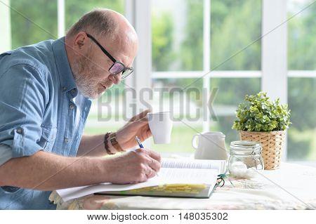 Portrait of elderly happy man with book