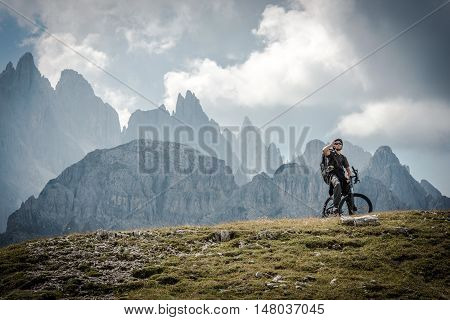 High Mountains Bike Ride. Caucasian Sportsman on the Ride Through Scenic Mountains Landscape.