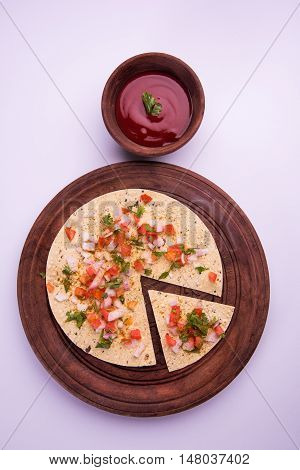 masala papad , indian vegetarian crispy food or starter served with tomato ketchup or sause