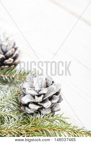 Christmas background with decoration with cones and twig