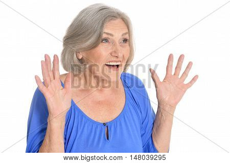 Portrait of surprised senior woman on white background