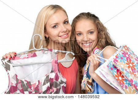 Portrait of Two Beautiful Girlfriends / Sisters with Shopping Bags and Clothes
