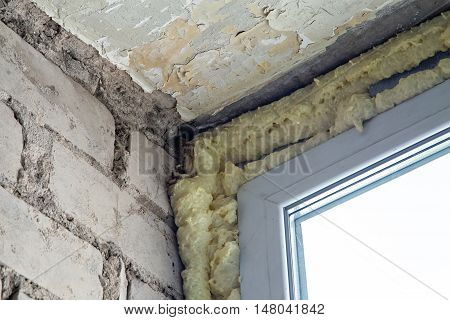 Polyurethane foam in the upper corner of the room