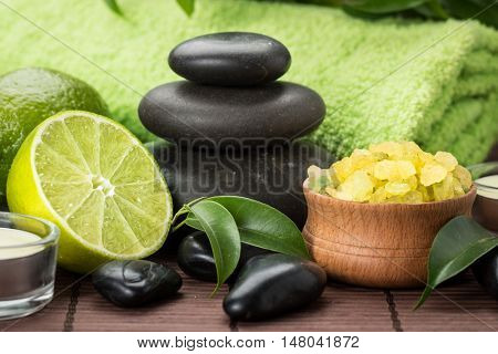 spa composition with lime ,stones and toning sea crystals