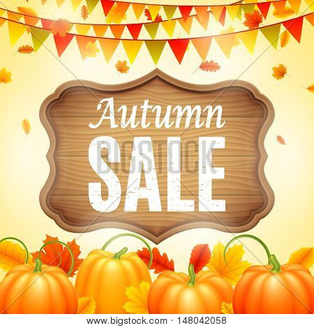 Autumn sale anouncement painted on vintage wooden signboard decorated with color leaves, orange pumpkins, and carnival paper garlands