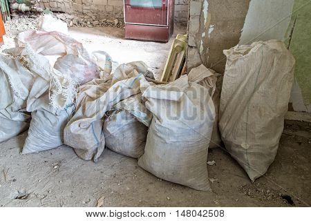 Heap of dirty sackful during capital repair