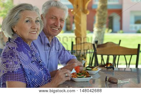 Happy Senior couple having lunch in cafe
