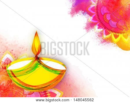 Creative Illuminated Lit Lamp made by abstract paint stroke on colourful splash Rangoli for Indian Festival of Lights, Happy Diwali Celebration.