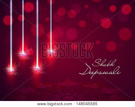 Elegant shiny blured background with Rangoli and Firecrackers for Indian Festival of Lights, Happy Diwali Celebration.