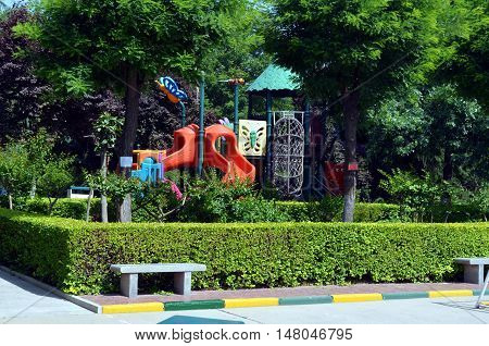 children's playground in the middle of a public park