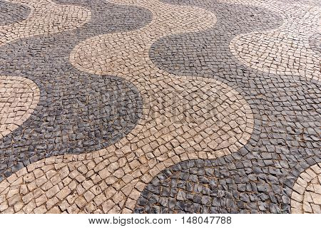 Typical portuguese cobblestone pavement on the street