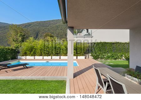 Place to relax under a porch, modern house with pool