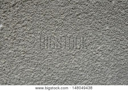Grey cement plaster on the wall texture