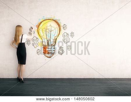 Side view of lady drawing light bulb sketch surrounded by dollar signs on concrete wall. Concept of bright idea. Toned image. Mockup