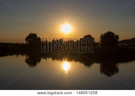landscape picturesque pond sunset in the evening