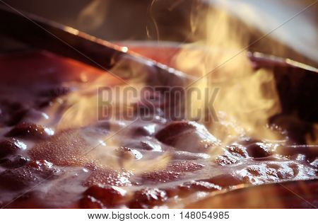 Fresh strawberry hot jam during cooking process