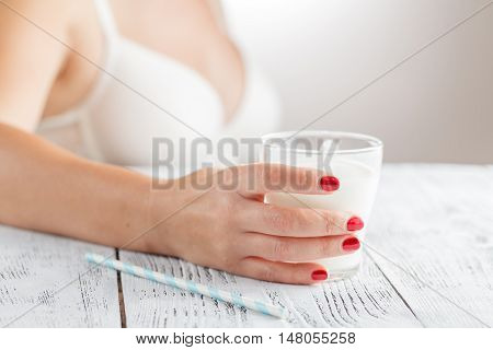 Woman On The Bedroom With Cup Of Milk In Hands
