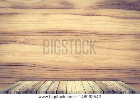 Teak wood shelf on teak texture background.