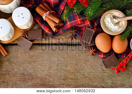 Christmas holidays concept. Ingredients for baking Christmas cake with space for text. Food background.