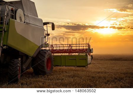 Harvesting The Field Of Wheat