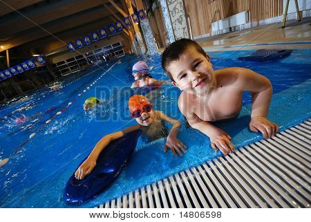 .happy childs in swimming pool