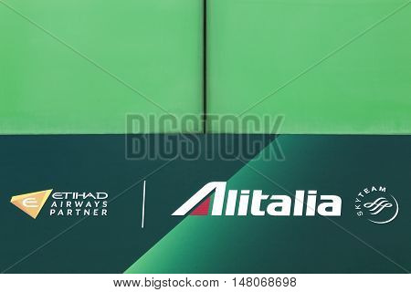 Milan, Italy - September 16, 2016: Alitalia logo on a wall. Alitalia is the flag carrier of Italy. The company has its head office in Fiumicino, Rome, Italy