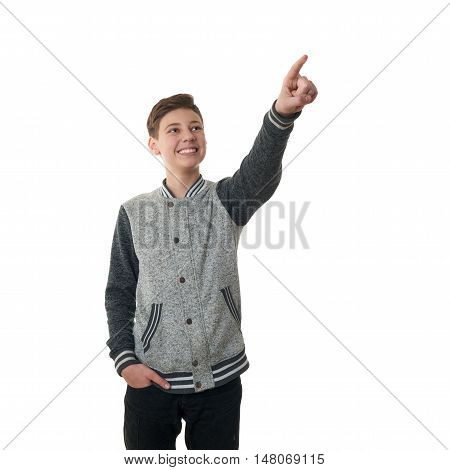 Cute teenager boy in gray sweater pointing up over white isolated background, half body
