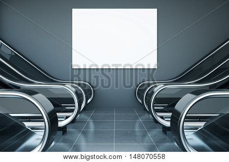 Interior with escalators and blank billboard on grey concrete wall. Mock up 3D Rendering