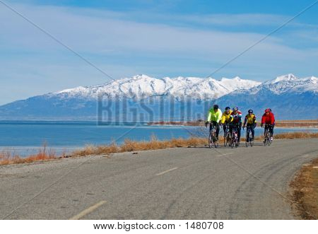 Cycling On A Lake Road