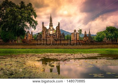 Sukhothai in Thailand sun set of historical ruins