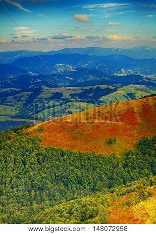 Colorful mountains landscape. Dramatic sky. Autumn time